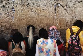 photo of people in front of a wall