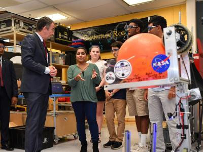 students with governor and robot